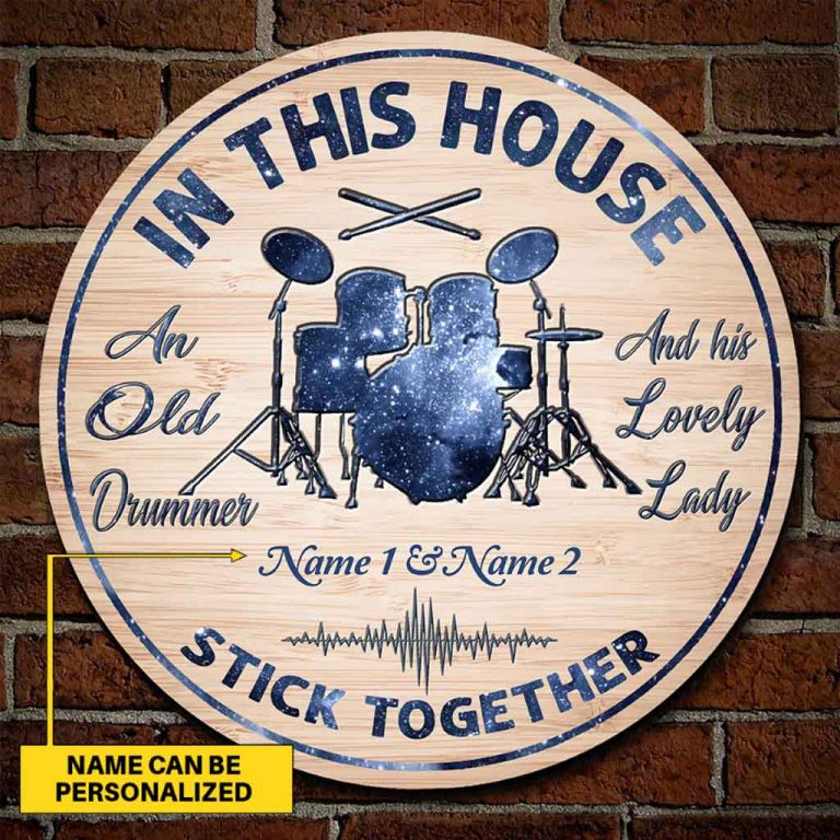 An old drummer personalized round wood sign